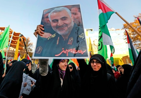 Iranian protesters hold a portrait of the commander of the Iranian Revolutionary Guard's Quds Force, Gen. Qassem Suleimani, during a demonstration in the capital Tehran on Dec. 11, 2017. (Atta Kenare/AFP via Getty Images)