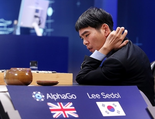 SEOUL, SOUTH KOREA - MARCH 13: In this handout image provided by Google, South Korean professional Go player Lee Se-Dol reviews the match after the fourth match against Google's artificial intelligence program, AlphaGo, during the Google DeepMind Challenge Match on March 13, 2016 in Seoul, South Korea. Lee Se-dol played a five-game match against a computer program developed by a Google, AlphaGo. (Photo by Google via Getty Images)