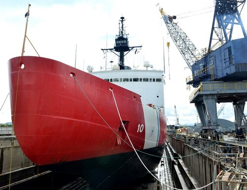 US Coast Guard Cutter Polar Star, the only one of its kind in the service, sits in dry dock facility undergoing depot-level maintenance. The increasing importance of Arctic missions is putting even more pressure on the development process for the next heavy polar icebreaker. (Petty Officer 1st Class Matthew S. Masaschi/DoD)