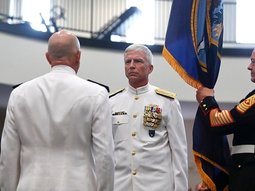 Secretary of Defense James Mattis, left, Adm. Kurt Tidd, center left, Adm. Craig Faller, center right, stand during a change of command ceremony at the U.S. Southern Command headquarters on Monday, Nov. 26, 2018, in Doral, Fla. The ceremony appointed Faller as new leader of the command that oversees U.S. military operations in Latin America and the Caribbean. (Brynn Anderson/AP)