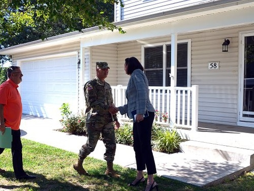 Gen. Gus Perna is greeted by Heather Plummer, Michaels Management Services vice president, before touring a renovated housing unit at Fort Leavenworth, Kan. (Bob Kerr/Army)
