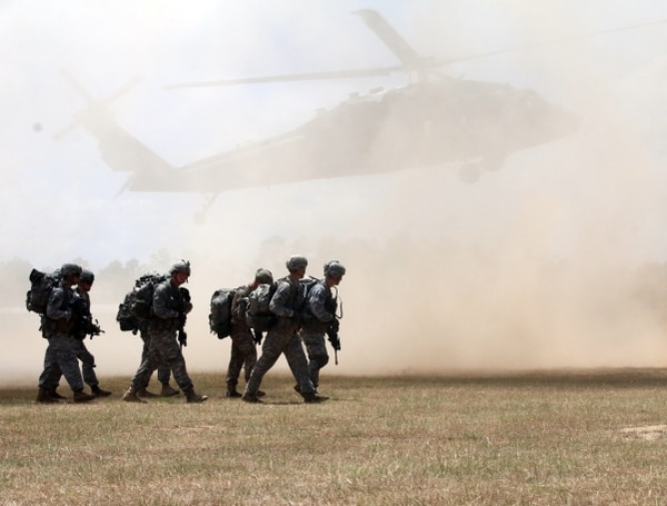 Paratroopers assigned with 1-508th Parachute Infantry Regiment, 3rd Brigade Combat Team, 82nd Airborne Division, move to their loading zone as rotor wash from a UH-60 black hawk caused a dust cloud. The UH-60's are assigned to the 82nd Combat Aviation Brigade, in support of Operation Red Fury. The 1-508th PIR will conduct an air assault into their objective. The training helped to increase the unit's interoperability between the ground and aviation units.