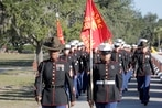 First company graduates in new dress blue uniform for female Marines