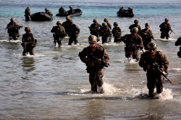 Philippine and U.S. Marines simulate a beach landing from combat rubber raiding crafts onto a small island off the coast of Palawan, Philippines, Oct. 2 during Amphibious Landing Exercise 2015. The amphibious assault and boat raids were conducted by U.S. Marines to complete a certification exercise being held in conjunction with PHIBLEX 15. PHIBLEX is an annual, bilateral training exercise conducted by the Armed Forces of the Philippines, U.S. Marines and Navy to strengthen interoperability across a range of capabilities, including disaster relief and contingency operations. The AFP Marines are with 12th Marine Battalion, Philippine Marine Corps, and the U.S. Marines are with Battalion Landing Team 3rd Battalion, 5th Marine Regiment, 31st Marine Expeditionary Unit. (U.S. Marine Corps photo by Sgt. Anthony J. Kirby/Released)