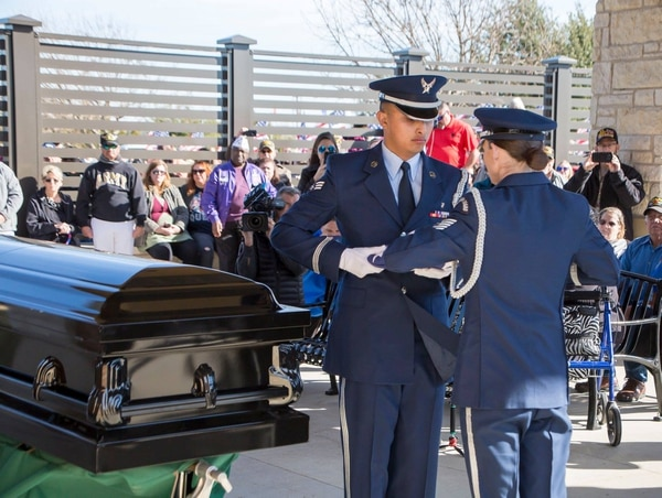 An Air Force honor guard folds the flag that was draped over Joseph Walker's casket. A woman who identified herself as Walker's daughter saw the news coverage and arrived at the service at the end. (From the Central Texas State Veterans Cemetery Facebook page)