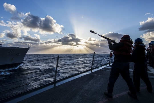 Sailors aboard the USS Carney prepare to send a shot line to the fleet replenishment oiler USNS Patuxent during an underway replenishment in the Aegean Sea, Jan. 3, 2018. (James R. Turner/Navy)