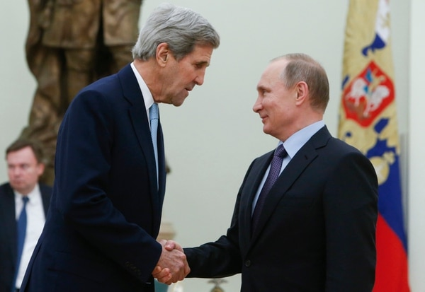 FILE - In this Tuesday, Dec. 15, 2015 file photo, U.S. Secretary of State John Kerry, left, shakes hands with Russian President Vladimir Putin during their meeting in the Kremlin in Moscow, Russia. The secretary of state under President Barack Obama, 2004 Democratic presidential candidate and former U.S. senator from Massachusetts was the target of at least five phishing emails during June-December 2015 at his Gmail address, according to data from the cybersecurity firm Secureworks. (Sergei Karpukhin/Pool Photo via AP)