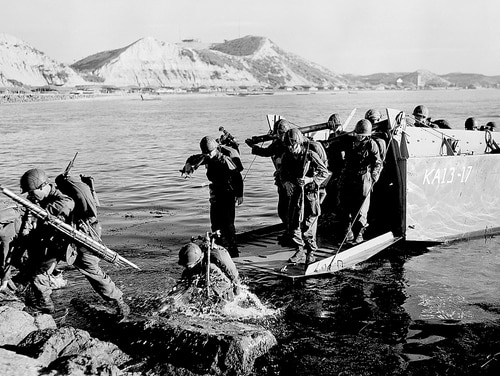 Troops of the First U.S. Cavalry Division land ashore at Pohang on the east coast of Korea on July 19, 1950. The remains of about 5,300 service members missing in action during the Korean War are believed to be on North Korean soil today. (AP)