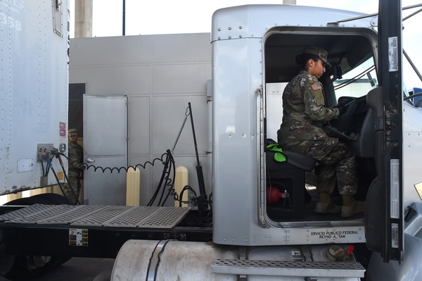 Army Pfc. Amber Popp, a patient administrative specialist with the Texas Army National Guard's F Company, 536th Brigade Support Battalion, inspects a semi-truck for illegal drugs and other prohibited items on Aug. 21, 2018, while working with U.S. Customs and Border Protection agents at the Customs and Border Protection's Pharr Port of Entry inspection station in Pharr, Texas. (Sgt. 1st Class Jon Soucy/Army)