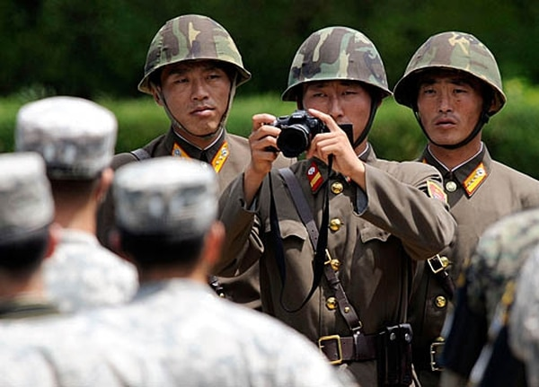 North Korean soldiers look at U.S. soldiers during the 57th anniversary of signing the ceasefire agreement ceremony on July 27, 2010, in Panmunjom, South Korea. (Song Kyung-Seok-pool/Getty Images)