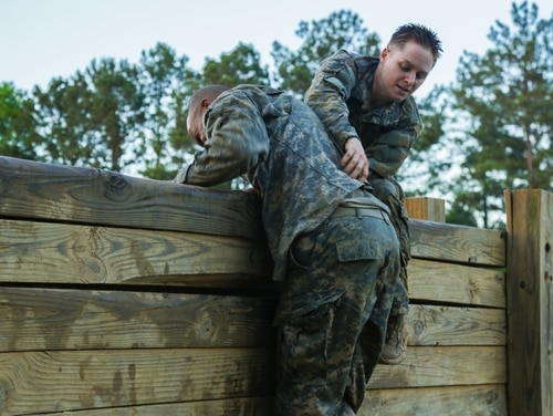 U.S. Army Soldiers conduct The Darby mile and an obstacle course during the Ranger Course on Fort Benning, Ga., April 21, 2015. Soldiers attend Ranger school to learn additional leadership and small unit technical and tactical skills in a physically and mentally demanding combat simulated environment. (U.S. Army photo by Spc. Dacotah Lane/Released Pending Review)