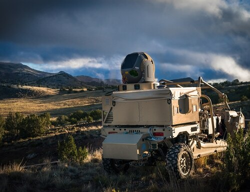 Mounted on the back of a dune buggy, the Raytheon-built High Energy Laser Weapon System (HELWS) uses directed energy to defeat incoming unmanned aerial systems. (Raytheon)