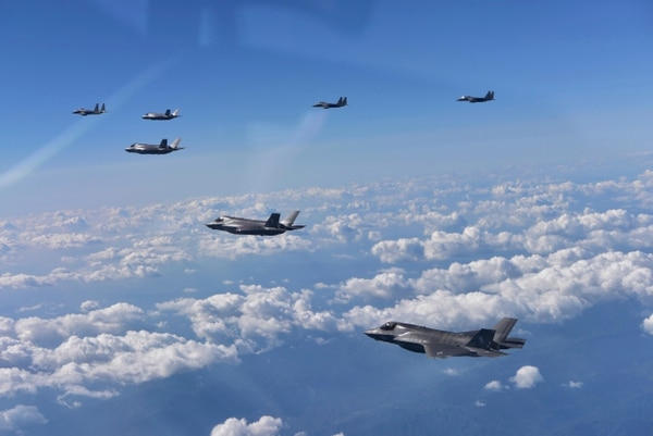 U.S. Air Force F-35 stealth fighter jets and South Korean F-15 fighter jets fly over the Korean Peninsula on the South Korean side on Aug. 31, 2017. (South Korean Defense Ministry via AP)
