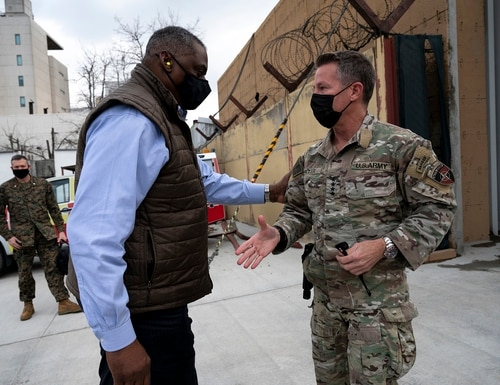 Secretary of Defense Lloyd Austin, left, greets the commander of NATO's Resolute Support Mission and U.S. Forces – Afghanistan, Army Gen. Scott Miller, upon arrival at Resolute Support Headquarters in Kabul, Afghanistan, March 21, 2021. (Lisa Ferdinando/DoD)