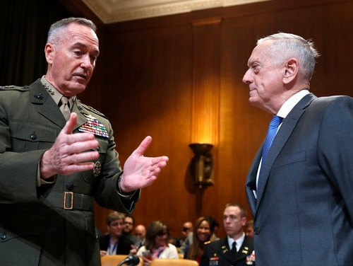Joint Chiefs Chairman Gen. Joseph Dunford, left, speaks with Defense Secretary Jim Mattis, as they arrive to a Senate Appropriations subcommittee hearing on the FY19 budget, Wednesday, May 9, 2018, on Capitol Hill in Washington. (AP Photo/Jacquelyn Martin)