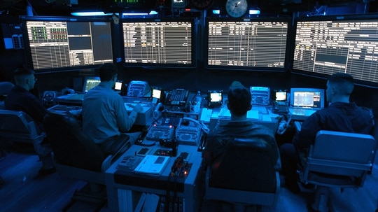 Air Traffic Controllers stand watch in the Carrier Air Traffic Control Center (CATCC) aboard USS George Washington (CVN 73). The Norfolk, Va., - based nuclear powered aircraft carrier is on a regularly scheduled deployment in support of Operation Iraqi Freedom (OIF). U.S. Navy photo by Photographer's Mate Airman Jessica Davis.