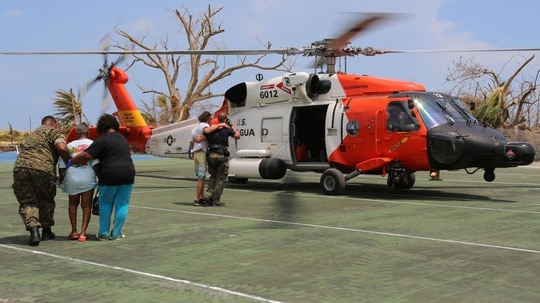 A Coast Guard Air Station Clearwater MH-60 Jayhawk helicopter crew helps in support of search and rescue and humanitarian aid in the Bahamas, Sept. 4, 2019. (U.S. Coast Guard photo by Seaman Erik Villa Rodriguez)
