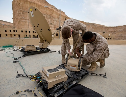 U.S. Marines set up a Hawkeye III Lite satellite communication device during Exercise Eager Lion on May 12, 2015. (Cpl. Sean Searfus/Marine Corps)