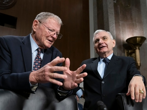 Senate Armed Services Committee Chairman Jim Inhofe, R-Okla., left, and ranking member Jack Reed, D-R.I., confer before a hearing on the Pentagon budget on March 14, 2019. (J. Scott Applewhite/AP)