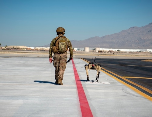 Tech. Sgt. John Rodiguez patrols with a Ghost Robotics Vision 60 prototype at a simulated austere base during the Advanced Battle Management System exercise on Nellis Air Force Base, Nev., on Sept. 3, 2020. (Airman First Class Zachary Rufus/U.S. Air Force)