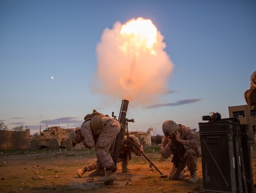 U.S. Marines fire a 120mm mortar round during a registration mission in an undisclosed location of southwest Asia, on Dec. 20, 2018, while supporting Operation Inherent Resolve — the defeat-ISIS coalition. (Sgt. Matthew Crane/Army)