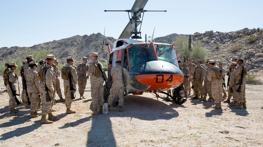 Marines and sailors stationed on Marine Corps Air Station Yuma talk one-on-one with the search and rescue team during