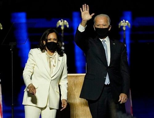 President-elect Joe Biden, right, on stage with Vice President-elect Kamala Harris on Nov. 7, 2020, in Wilmington, Del. (Andrew Harnik/AP)
