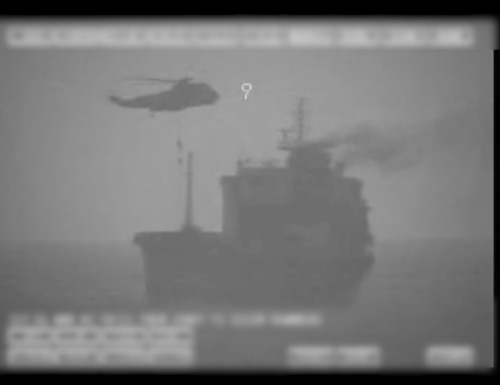 In this image made from video released by the U.S. military's Central Command, Iranian commandos fast-rope down from a helicopter onto the MV Wila oil tanker in the Gulf of Oman off the coast of the United Arab Emirates on Wednesday, Aug. 12, 2020. (U.S. military's Central Command via AP)