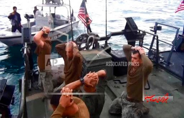 This image from a Jan. 12, 2016, video by the Iranian state-run IRIB News Agency shows the detention of Navy sailors by the Islamic Revolutionary Guard Corps in the Persian Gulf. (IRIB News Agency via AP)