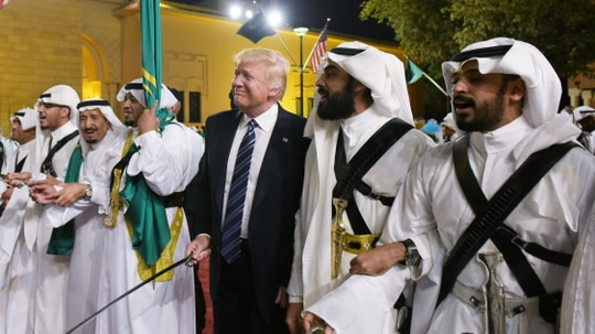 U.S. President Donald Trump joins dancers with swords at a welcome ceremony ahead of a banquet at the Murabba Palace in Riyadh, Saudi Arabia, on May 20, 2017. (Mandel Ngan/AFP via Getty Images)