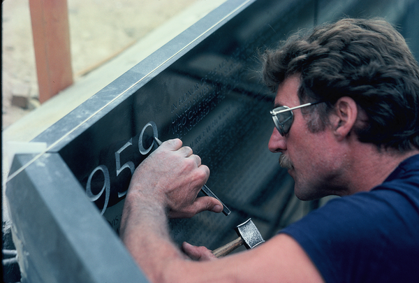 John Benson carves the date 1959 into what would become the Vietnam Veterans Memorial. (Courtesy photo via Robert W. Doubek)