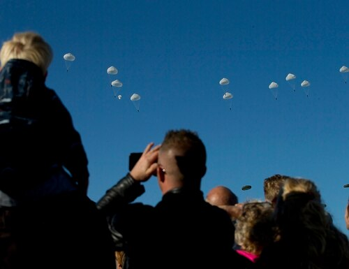 Spectators watch a mass parachute drop at Ginkel Heath, eastern Netherlands, Saturday, Sept. 21, 2019, as part of commemorations marking the 75th anniversary of Operation Market Garden, an ultimately unsuccessful airborne and land offensive that Allied leaders hoped would bring a swift end to World War II by capturing key Dutch bridges and opening a path to Berlin. (Peter Dejong/AP)