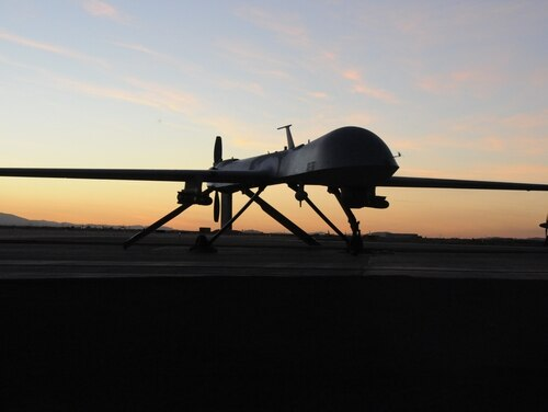 The 163rd Reconnaissance Wing MQ-1 Predator is shown during post flight inspection at dusk from Southern California Logistics Airport (formerly George Air Force Base) in Victorville, Calif., Jan. 7, 2012.
