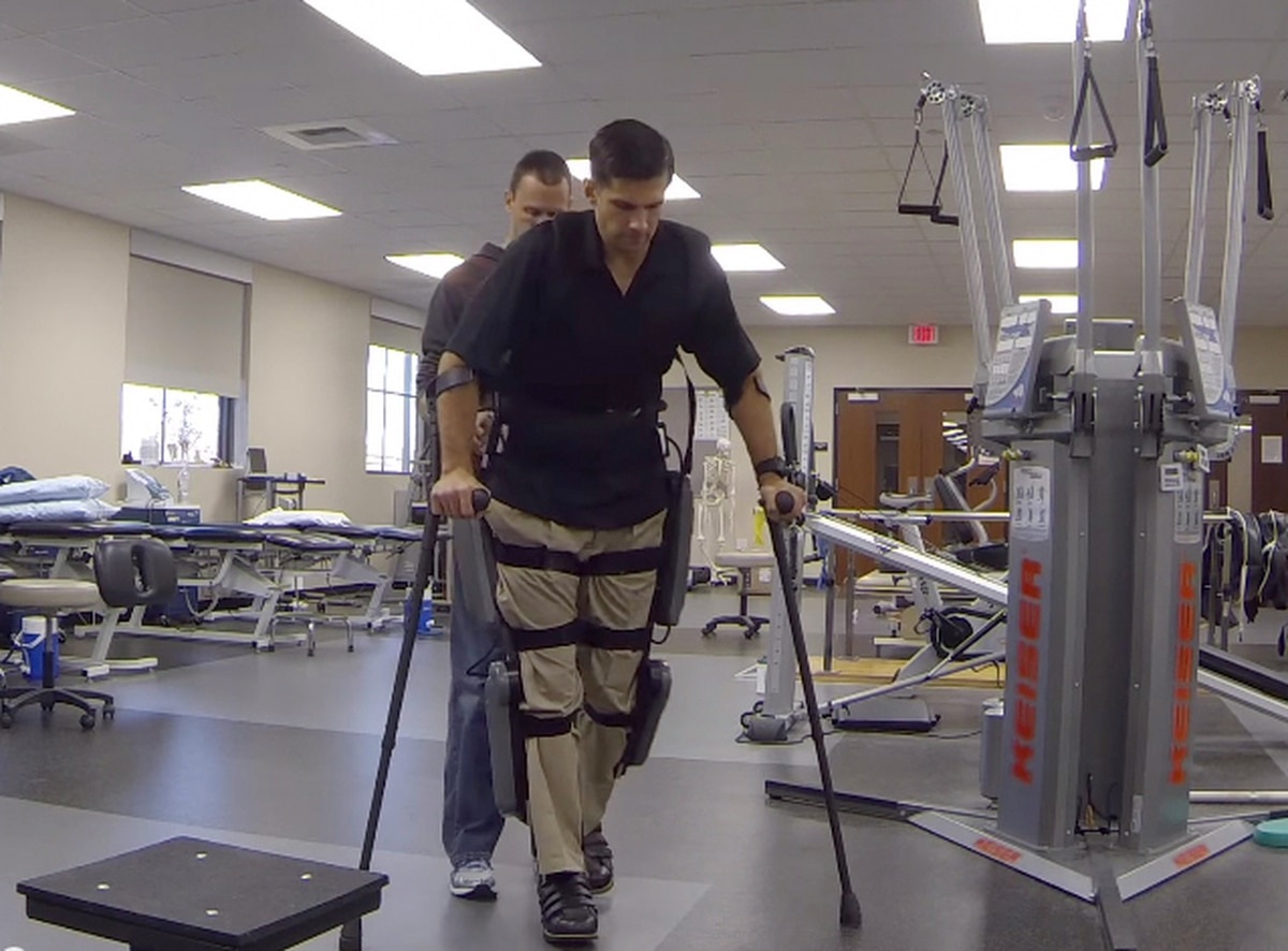 Marine paralyzed by sniper's bullet walks with use of
