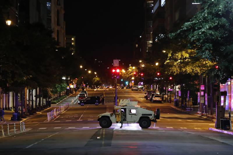 A military Humvee blocks an intersection along K Street in downtown Washington as demonstrators protest the death of George Floyd, Monday, June 1, 2020, in Washington.