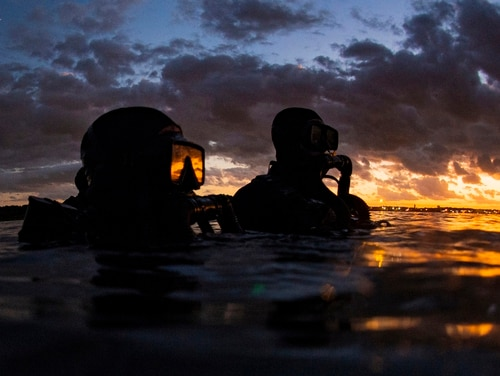 Naval Special Warfare Group 2 members dive off the East Coast on Sept. 18. A string of scandals and the firing of a team leadership triad put Naval Special Warfare in the spotlight. (Senior Chief Mass Communication Specialist Jayme Pastoric/Navy)