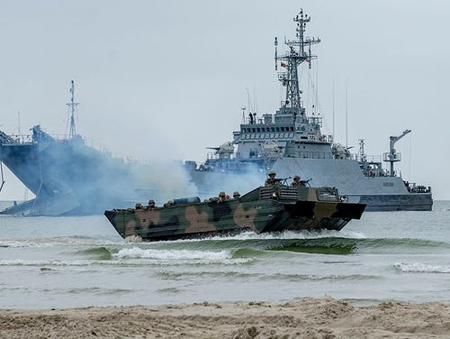 A Polish landing craft delivers Spanish, Romanian and U.S. Marines to a Lithuanian beach during an amphibious landing exercise during this year's BALTOPS. (Mass Communication Specialist 2nd Class Joshua M. Tolbert/Navy)