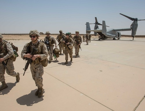 U.S. Marines debark from an MV-22B Osprey at Al Asad Air Base, Iraq in June 2018. A cyberattack could slow how U.S. forces respond to a battlefield. (Cpl. Jered T. Stone/Marine Corps)