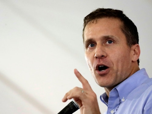 Missouri Republican Gov. Eric Greitens addresses the crowd during the Governor's Ham Breakfast at the Missouri State Fair in Sedalia, Mo. Greitens is alleged to have blackmailed a woman with nude photos to avoid publicity of an affair. (AP Photo/Charlie Riedel, File)