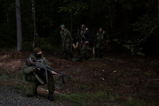 Members of Lithuania's National Volunteer Defence Force (KASP) and Bulgarian Special Operations Forces perform a medical evacuation during exercise Saber Junction at Bogen Local Training Area, Bogen, Germany, 2018 September 25, 2018. SOF worked alongside the KASP during Saber Junction 18 to conduct irregular warfare in enemy occupied territory to support the U.S. Army's 173rd Airborne Brigade as they executed land operations in a multinational joint environment. (U.S. Army photo by Sgt. Karen Sampson)