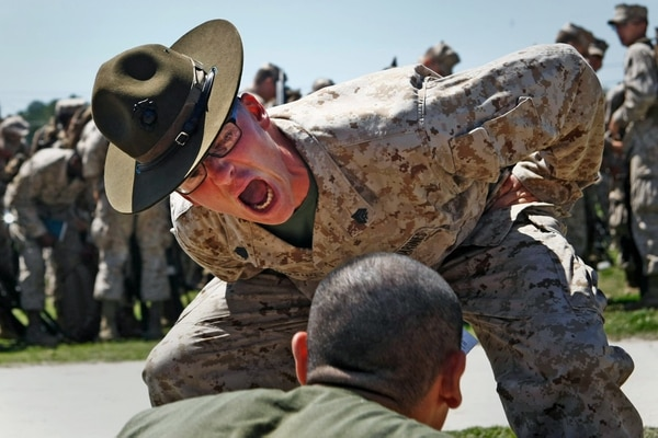 Sgt. Justin Glenn Burnside motivates a recruit with Echo Company, 2nd Recruit Training Battalion at Marine Corps Recruit Depot Parris Island, S.C. Burnside, originally a signal intelligence specialist from Bristol Fla., is one of about 600 drill instructors who shape the approximately 20,000 recruits through Parris Island annually into United States Marines. This handful of dedicated DIs is entrusted with sustaining a more than 237-year legacy. (U.S. Marine Corps photo by Lance Cpl. David Bessey)