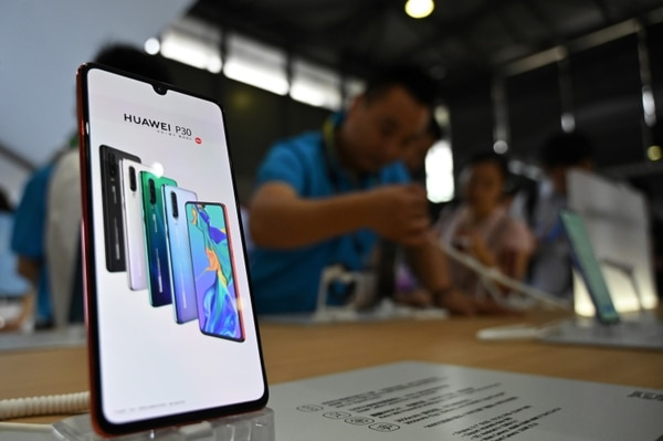 People visit a Huawei stand during the Mobile World Congress introducing next-generation technology at the Shanghai New International Expo Centre in Shanghai on June 26. (Hector Retamal/AFP/Getty Images)