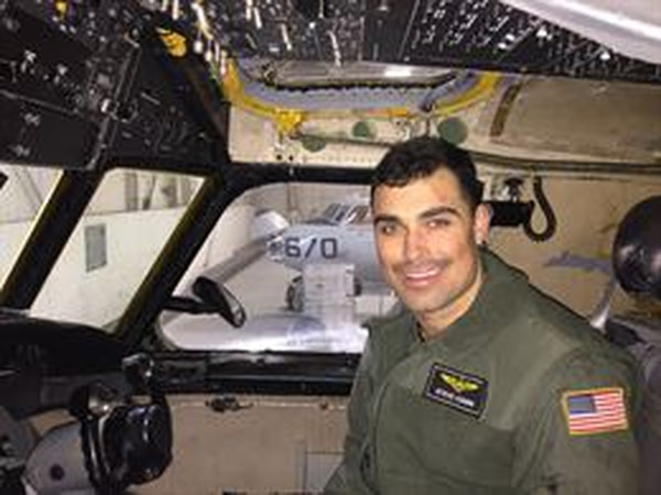 """Lt. Steven Combs, a native of Florida, was assigned to the """"Providers"""" of Fleet Logistics Support Squadron (VRC) 30 and embarked aboard USS Ronald Reagan (CVN 76) as part of Carrier Air Wing Five. (Photo by courtesy photo)"""