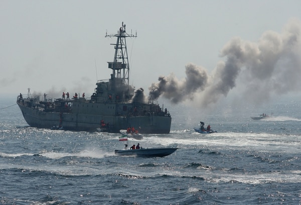 CORRECTING NAME OF THE GULF IN IPTC Members of Iran's elite Revolutionary Guard show their skills in attacking a naval vessel during military exercises in the Gulf on April 22, 2010. Iran's elite Revolutionary Guards launched a new
