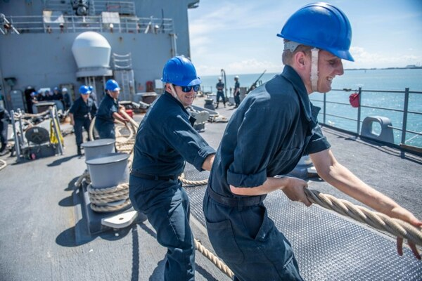Sailors heave line on the fo'c'sle of the amphibious dock landing ship Harpers Ferry during Cooperation Afloat Readiness and Training (CARAT) Brunei on Oct. 14. (Mass Communication Specialist 3rd Class Danielle A. Baker/Navy)
