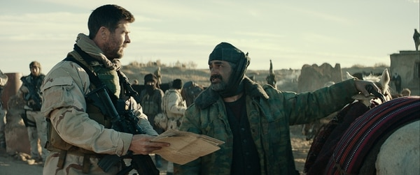 Chris Hemsworth, as Capt. Mitch Nelson, and Navid Negahban, as Gen. Dostum, share a moment in