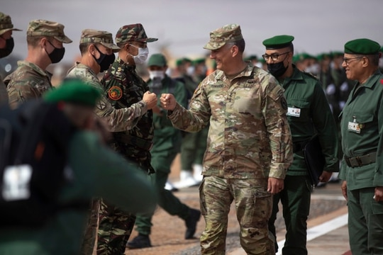 Gen. Stephen J. Townsend, head of the United States Africa Command, center, arrives alongside General Belkhir el-Farouk, Right, Moroccan Southern Zone Commander, to his right, to watch a large scale drill as part of the African Lion military exercise, in Tantan, south of Agadir, Morocco, Friday, June 18, 2021. (AP Photo/Mosa'ab Elshamy)