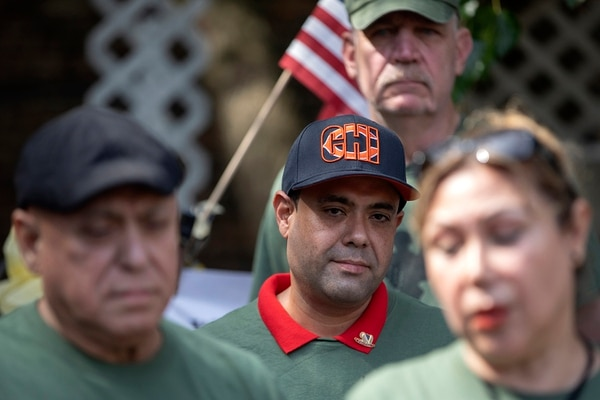 U.S. Army veteran Miguel Perez Jr. stands with his mother Esperanza Perez at a news conference Tuesday, Sept. 24, 2019, at Lincoln Methodist Church in Chicago. (Erin Hooley/Chicago Tribune via AP)