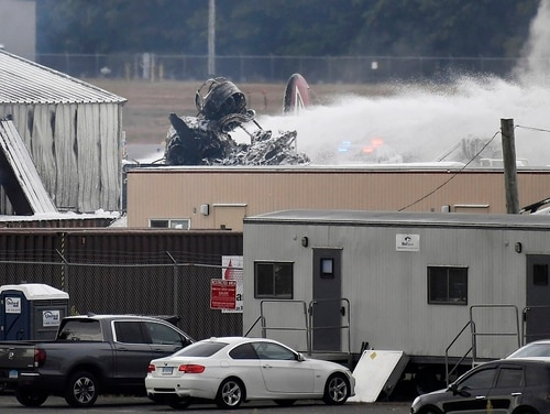 A fire-and-rescue operation is underway where a World War II-era B-17 bomber crashed at Bradley International Airport in Windsor Locks, Conn., Wednesday. (Jessica Hill/AP)