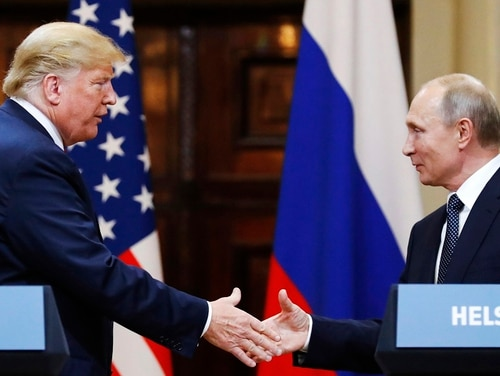 U.S. President Donald Trump, left, is expected to remove the U.S. from a 30-year-old arms control treaty with Russia. (Alexander Zemlianichenko/AP)